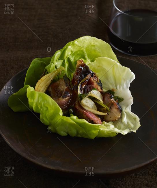 Pork belly served in crisp butterhead lettuce