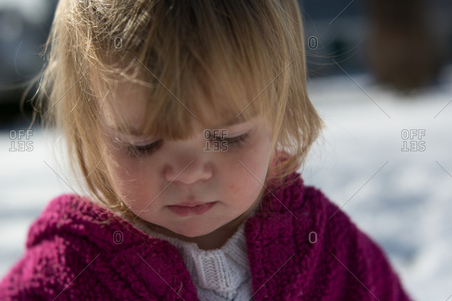 Closeup of toddler girl in a pink sweater