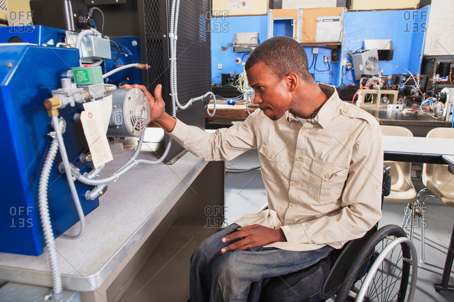 Student in wheelchair in a engineering lab