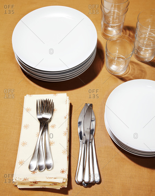 Stack of silverware and dinnerware on a table