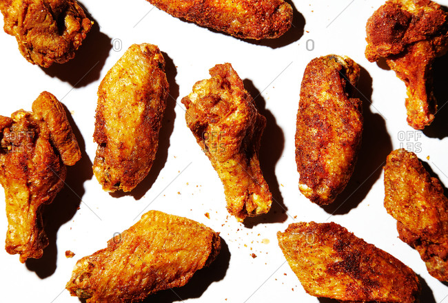 Dry rub hot wings on a white background