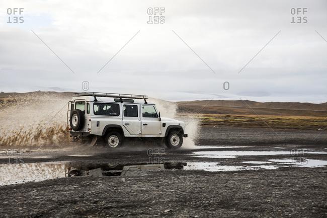 Jökulsárlón, Iceland - October 6, 2015: SUV splashing in Iceland