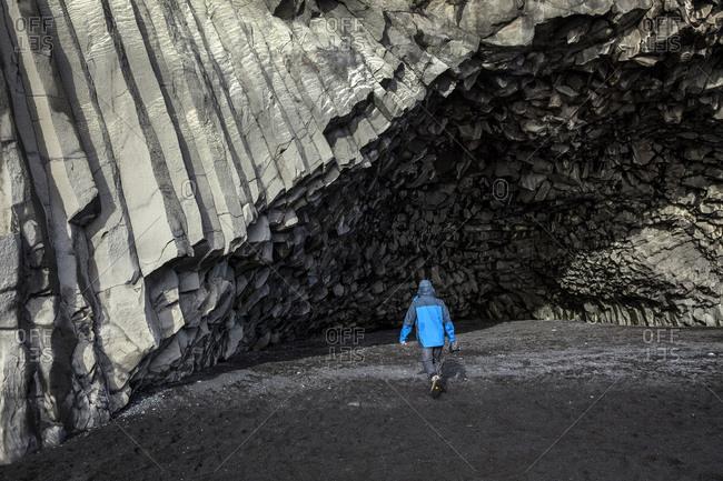 Man walking near geological formations