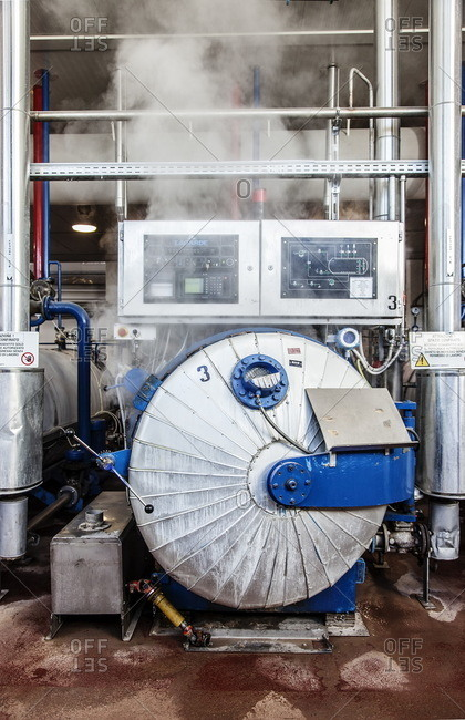 Como, Italy - April 1, 2015: Steam coming from a sterilization machine at a tuna factory in Italy