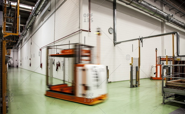 Como, Italy - April 1, 2015: Robotic machinery moving on the floor of a tuna factory in Como, Italy