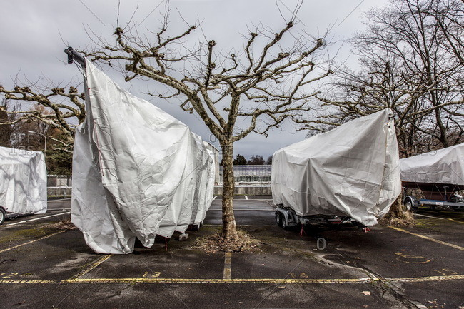 Parked boats covered in tarps by the lake in Zurich, Switzerland