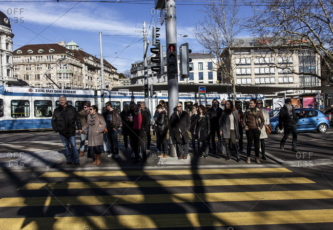 Zurich, Switzerland  - February 21, 2016: Pedestrians waiting to cross the street in Zurich, Switzerland