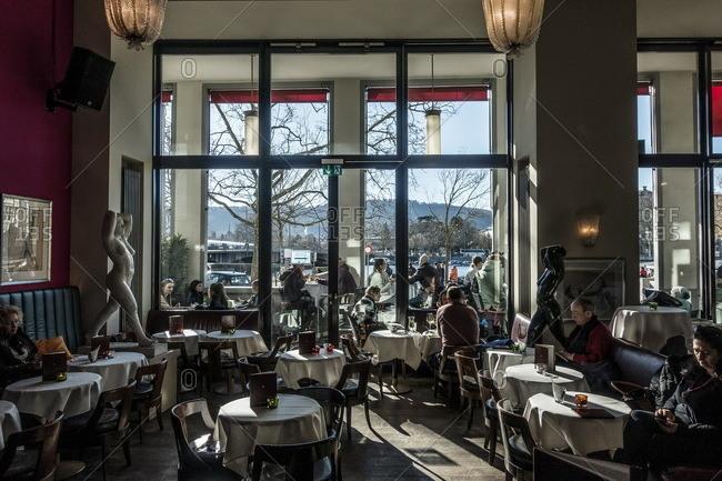 Zurich, Switzerland  - February 21, 2016: Elegant restaurant dining room in Switzerland