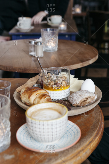 A Danish breakfast spread with a cup of coffee