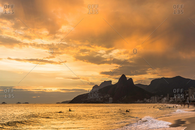 View of Ipanema Beach and Padre Dois Irmaos against dramatic sunset, Rio De Janerio, Brazil