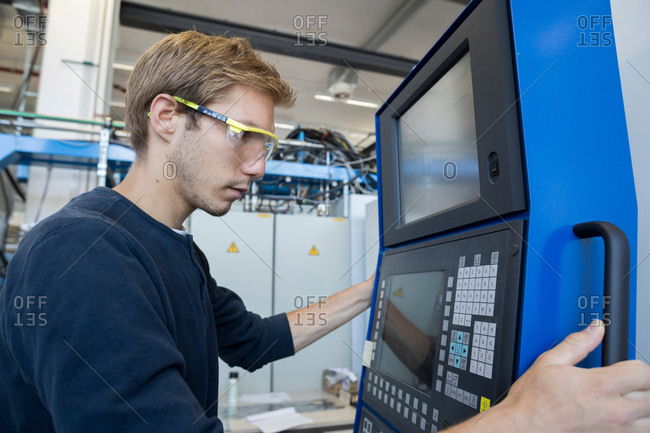 Factory technician working on control panel