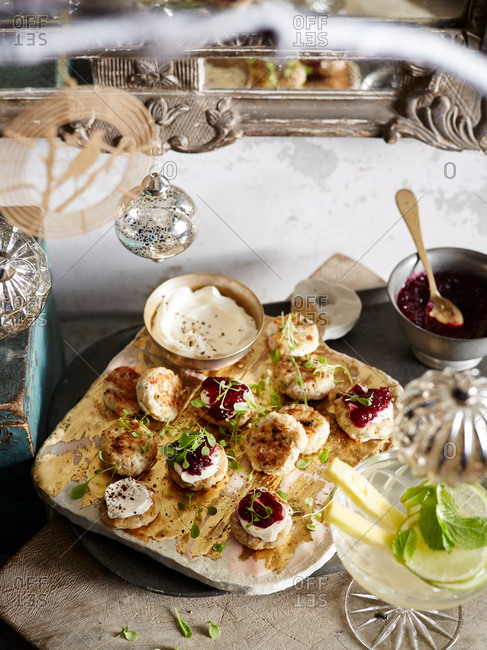 Sage and mustard chicken patties with micro herbs and cranberry relish