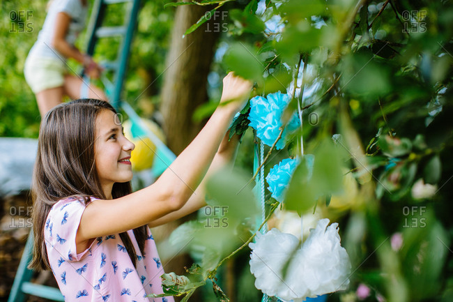 Girl decorating yard for summer party