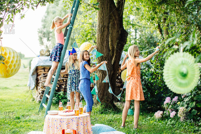 Girls decorating garden for party