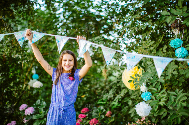 Girl decorating garden for summer party