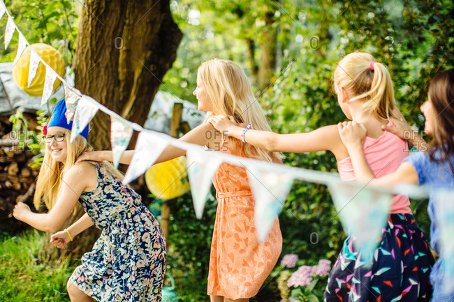 Girls dancing around at summer garden party