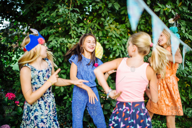 Girls dancing at summer garden party