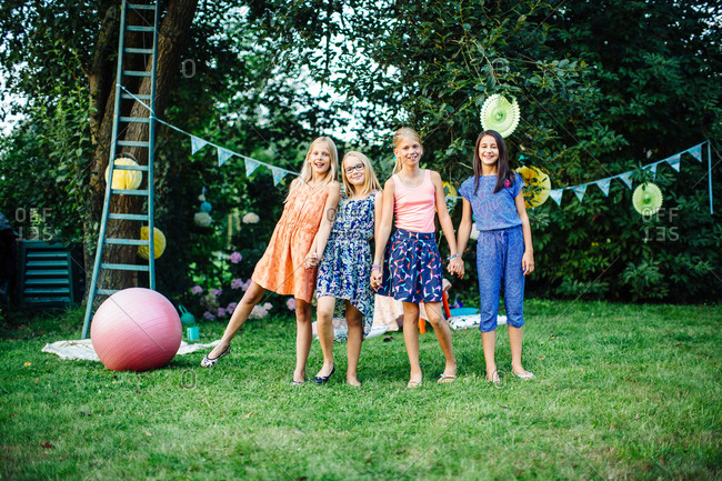 Girls decorating garden for summer party