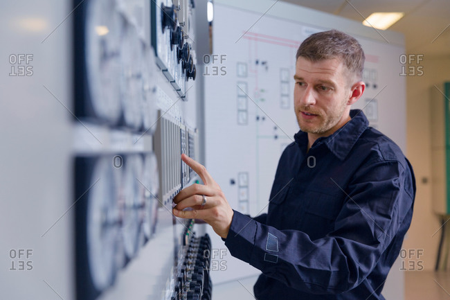 Engineer using control panel at geothermal power station