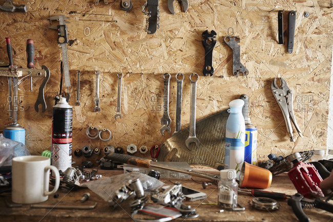A workbench and tool board in a cycle repair