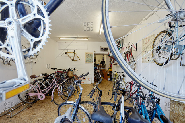 A bicycle shop, stocked with sports bikes, mountain and road bicycles