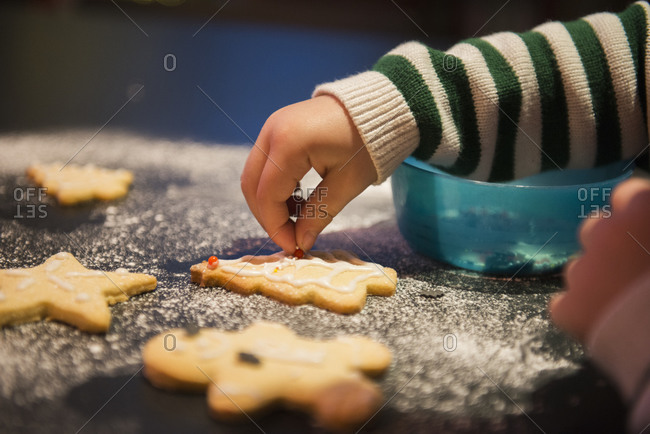 A child decorating Christmas biscuits