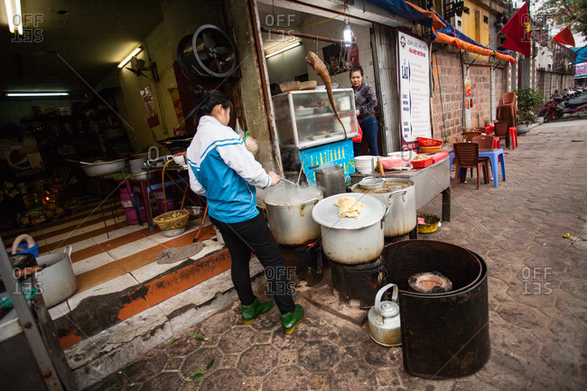 Hanoi, Vietnam - January 19, 2016: Unknown meats are cooked into street-side meals