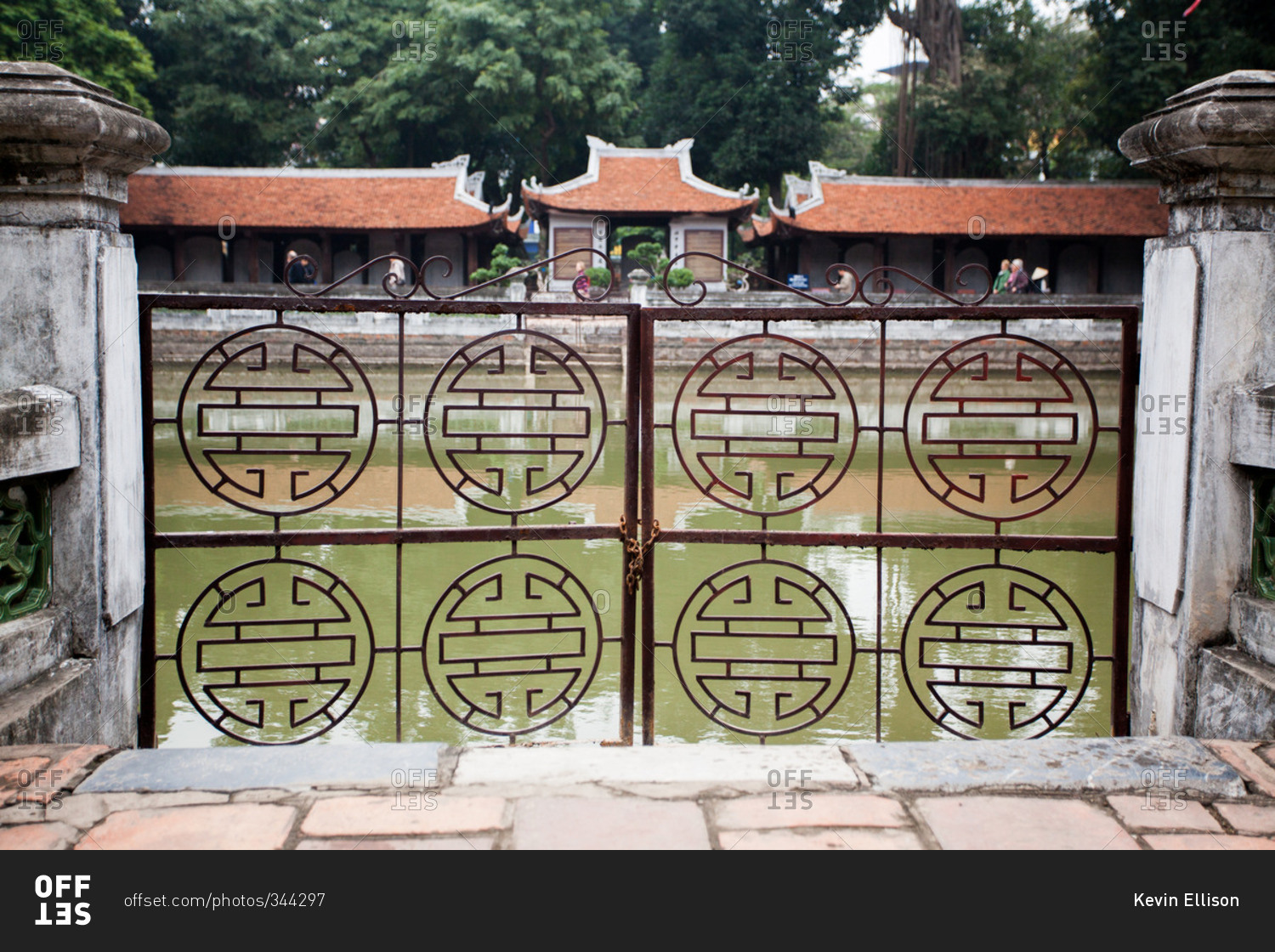 ornate wrought iron gate. ornate wrought iron gate surrounding a water feature at the temple of literature in hanoi