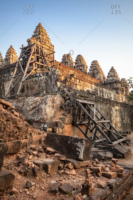 Restoration work continues at the ruins of Phnom Bakheng backlit by in Siem Reap, Cambodia