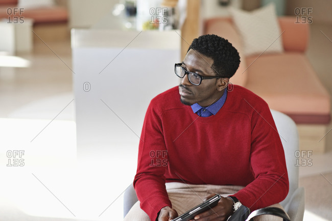 Man sitting in an office listening to a co-worker