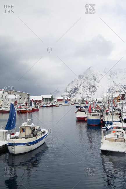 Boats in harbor in Henningsvaer in winter