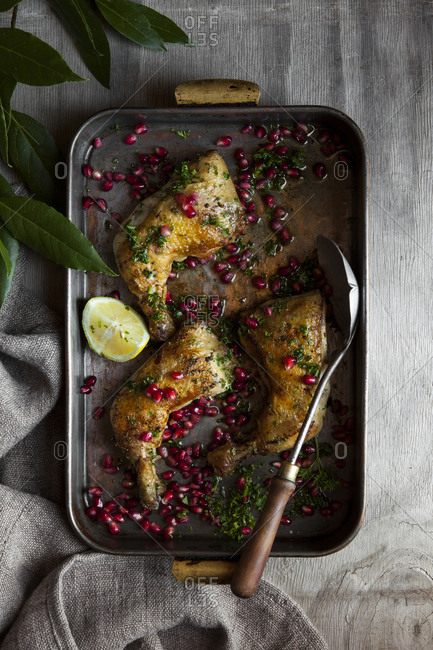 Pomegranate chicken served in a roasting pan