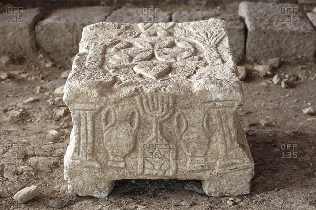 Replica of a carved stone with a menorah found in a first century synagogue in Magdala, Israel