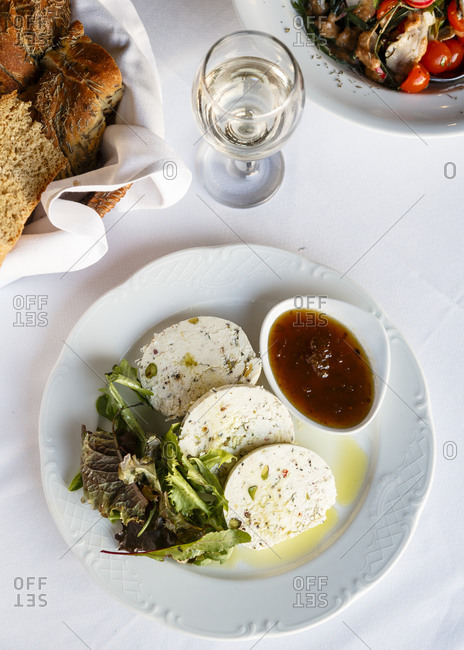 Home spiced sheep cheese with salad and jam at a gourmet Greek restaurant