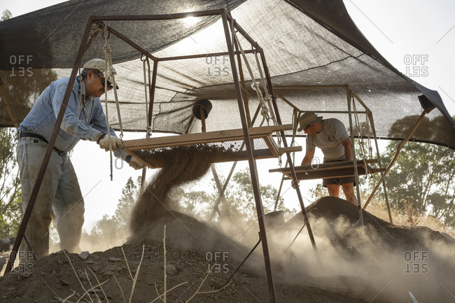 June 19, 2015: Men filtering buckets of earth at an archaeological dig, Bethsaida, Israel