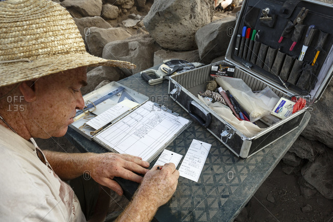 June 17, 2015: Archaeologist writing in his work log at a site in Bethsaida, Israel