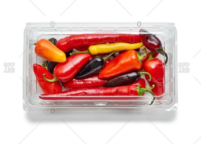 Multi-colored peppers in a plastic produce container