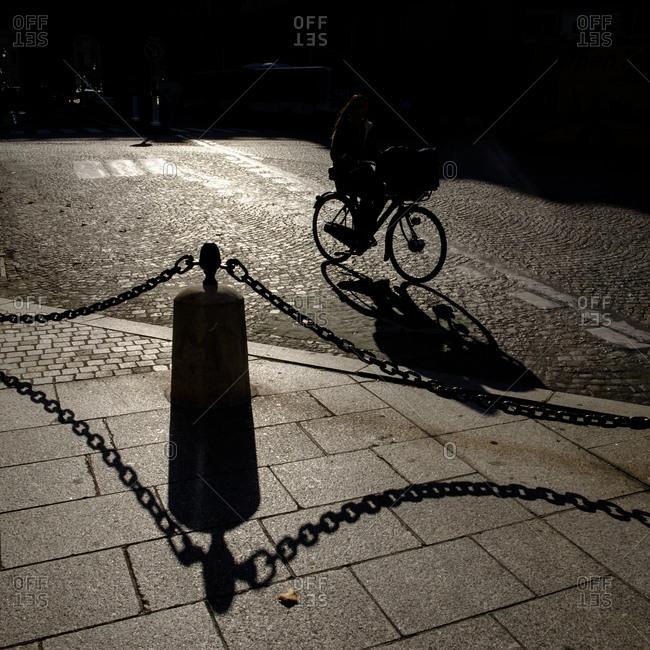 - April 5, 1904: Cyclist on shadowed street