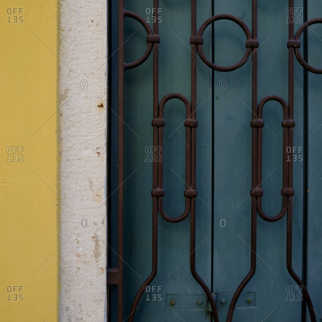 Grate over shutters, Venice, Italy