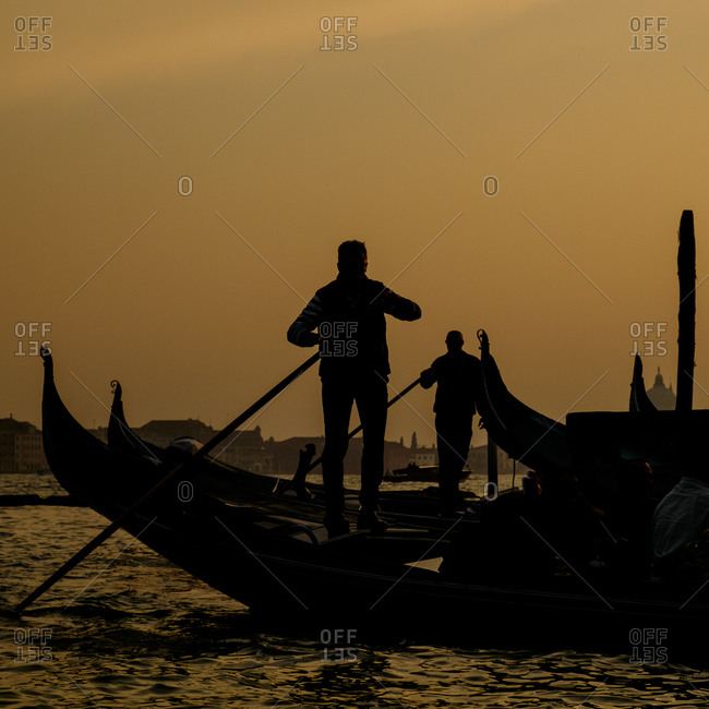 - April 5, 1904: Gondolier in silhouette in Venice, Italy