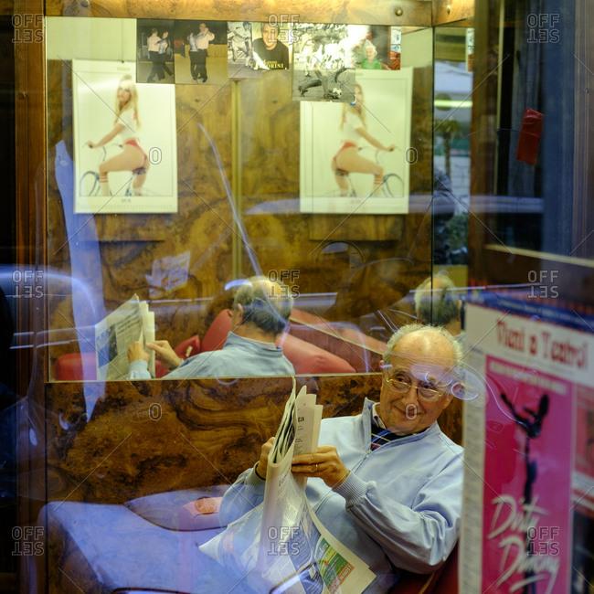 - April 5, 1904: Man reading newspaper, Rome, Italy
