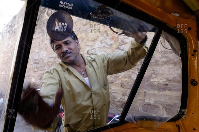 - April 5, 1904: Man washing car window, India