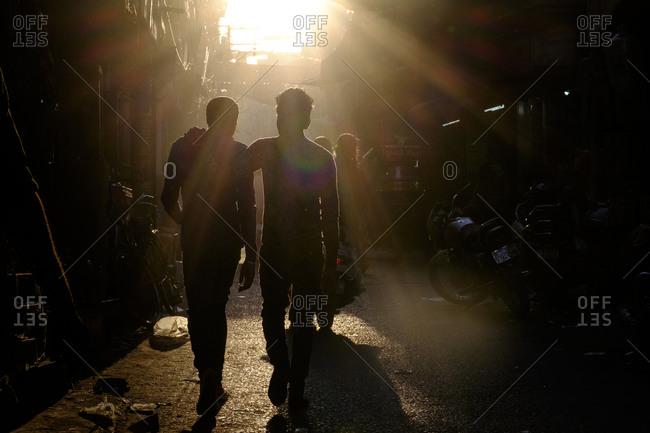 - April 5, 1904: Sunlight silhouetting people, Jodhpur, India
