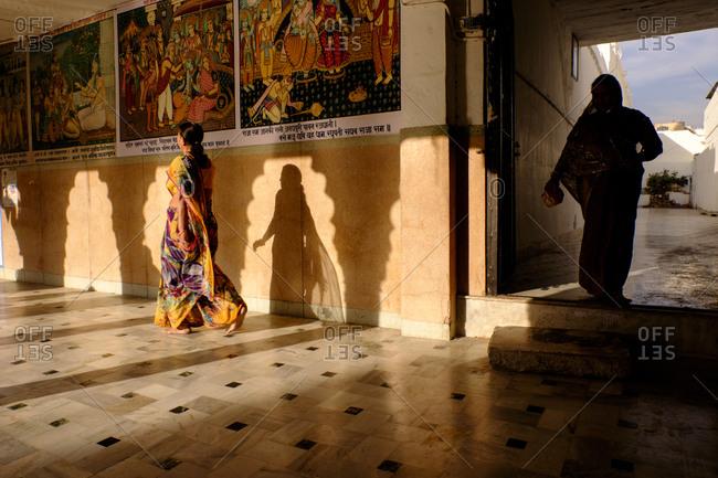 - April 5, 1904: Woman walking in sunlight, Jodhpur, India