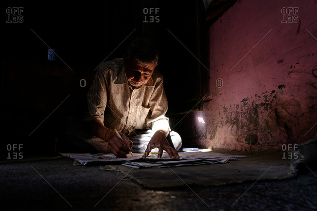 - April 5, 1904: Man writing by lamplight