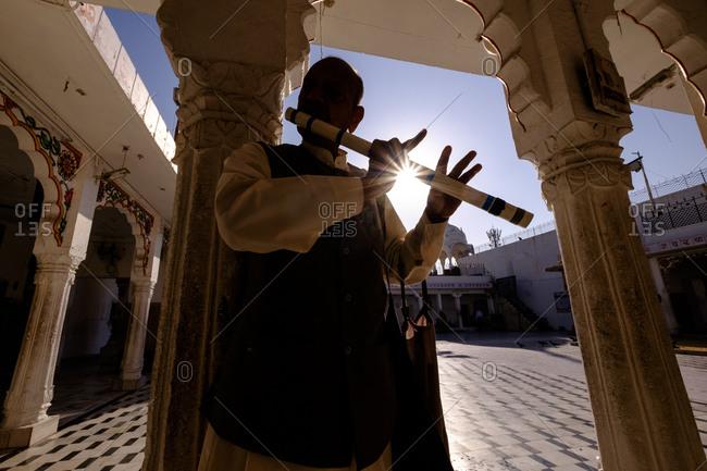 - April 5, 1904: Musician playing, Jodhpur, India