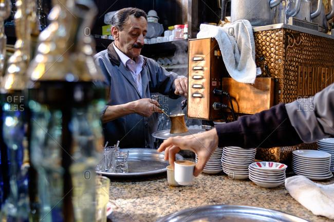 - April 5, 1904: Man making coffee, Istanbul, Turkey