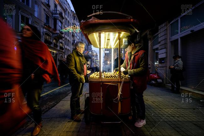 - April 5, 1904: Man buying street food, Istanbul, Turkey