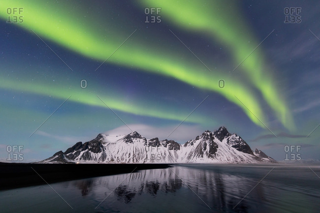 The aurora borealis and the Vestrahorn on a bright, moonlit night, eastern Iceland