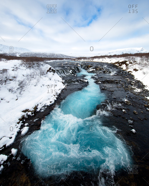 The cascades and glacial blue waters of Bruarfoss, Iceland